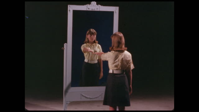 teenage girl reaches out to her reflection in mirror - only teenage girls stock videos & royalty-free footage
