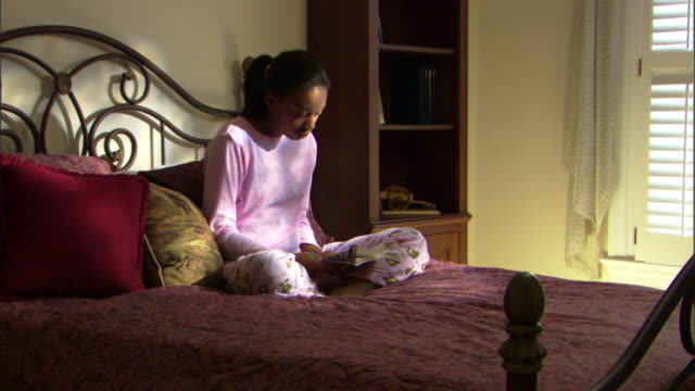 teenage girl reading book - one teenage girl only stock videos & royalty-free footage