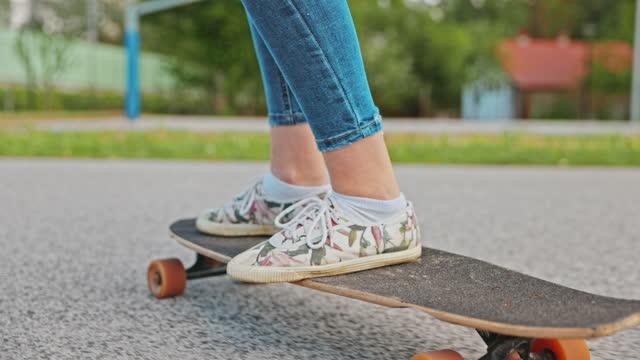 teenage girl riding on skateboard - human limb stock videos & royalty-free footage