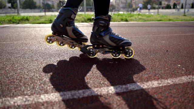 teenage girl rollerskating in park.close up - blade stock videos & royalty-free footage