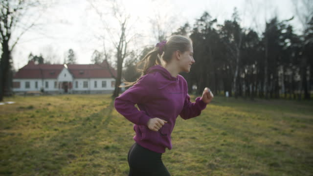 teenage girl running in park - cheerful stock videos & royalty-free footage