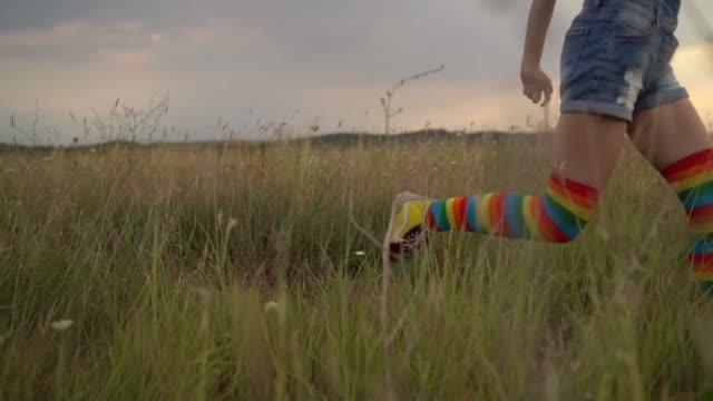 teenage girl running in the meadow - rainbow flag stock videos & royalty-free footage