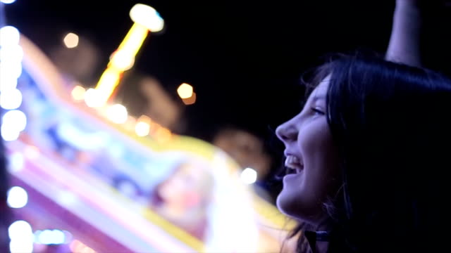 teenage girl screaming on carousel,close up - rollercoaster stock videos & royalty-free footage