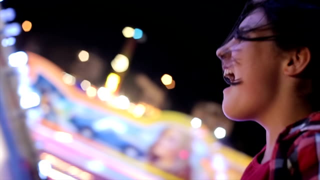 teenage girl screaming on carousel,close up - roundabout stock videos & royalty-free footage