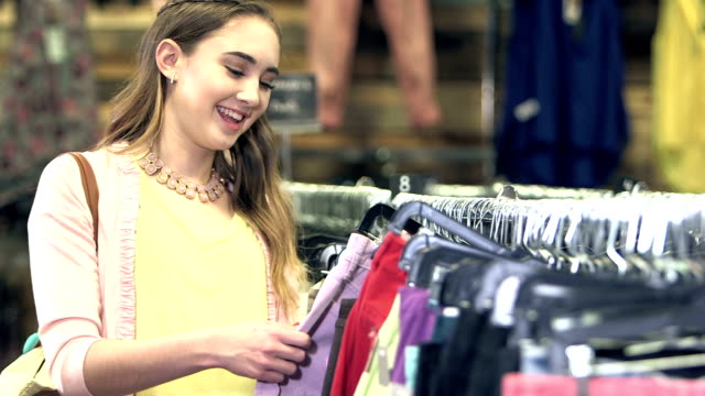 teenage girl shopping in clothing store - second hand stock videos & royalty-free footage