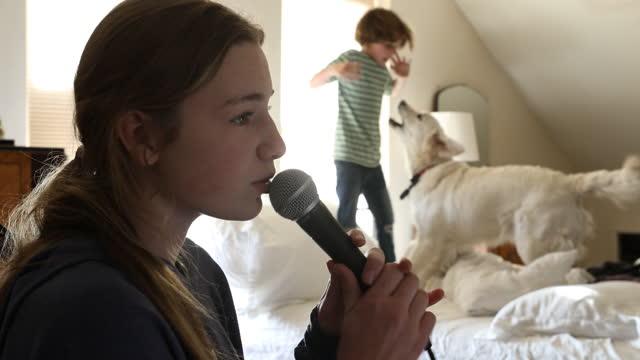 teenage girl singing into microphone - pop musician stock videos & royalty-free footage