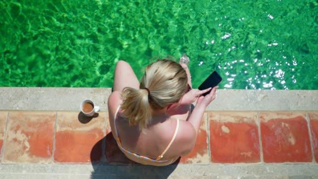 teenage girl sitting poolside - one teenage girl only stock videos & royalty-free footage