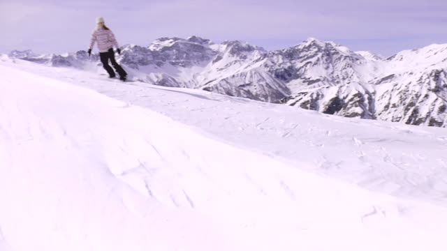 ws, pan, teenage girl (16-17) snowboarding, bardonecchia, piedmont, italy - one teenage girl only stock videos & royalty-free footage