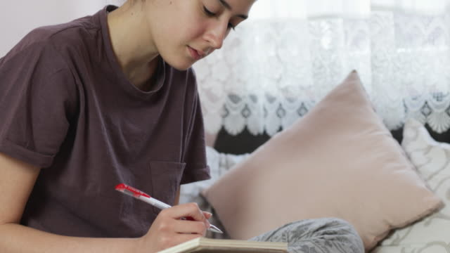 teenage girl studying at home during covid-19 pandemic - working in remote location stock videos & royalty-free footage