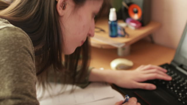 teenage girl studying at home during covid-19 pandemic - secondary school child stock videos & royalty-free footage