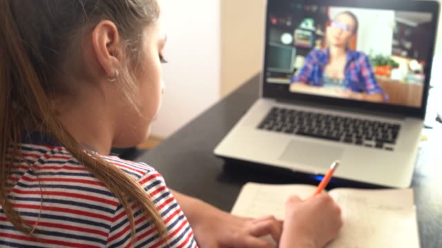 4k teenage girl studying with video online lesson at home   family in isolation - educazione video stock e b–roll