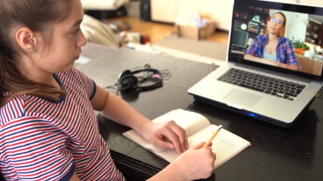 4k teenage girl studying with video online lesson at home   family in isolation - laptop remote location stock videos & royalty-free footage