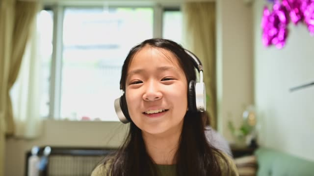 teenage girl studying with video online lesson at home. she is speaking to the camera on a video call. - leaning stock videos & royalty-free footage