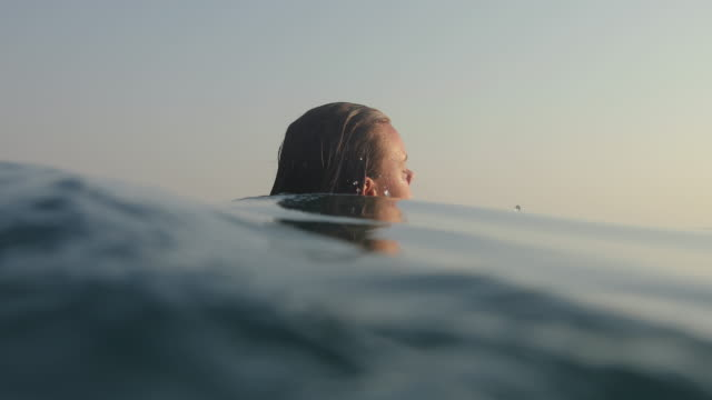 teenage girl swimming in open sea on summer vacation - breathing exercise stock videos & royalty-free footage