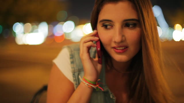 teenage girl talking on cell phone outdoors at night - only teenage girls stock videos & royalty-free footage