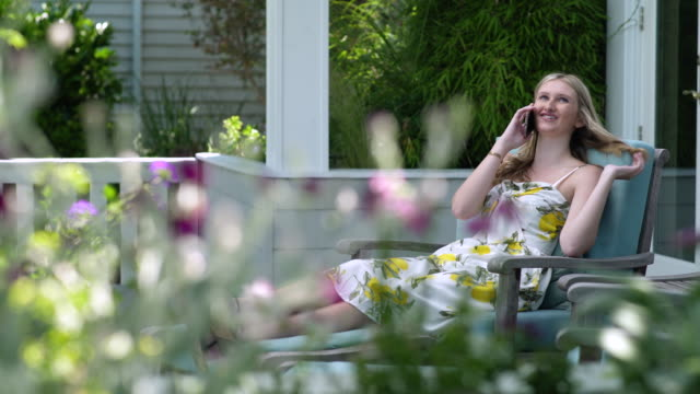 teenage girl talking on the phone outside - one teenage girl only stock videos & royalty-free footage
