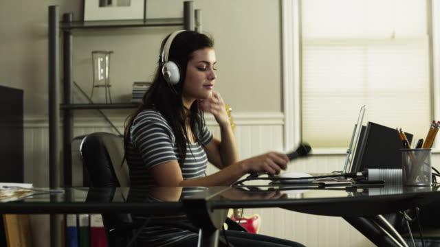 ms pan teenage girl (16-17) talking through microphone and using laptop / orem, utah, usa - orem utah stock videos & royalty-free footage