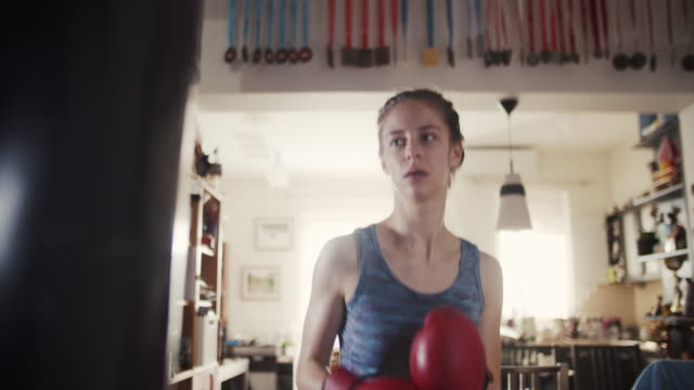 teenage girl training boxing with punching bag - punch bag stock videos & royalty-free footage