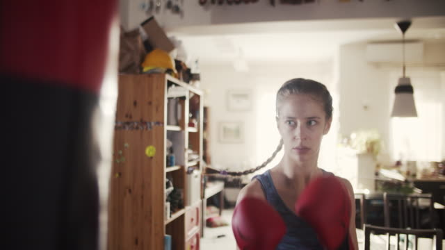 teenage girl training boxing with punching bag - combat sport stock videos & royalty-free footage
