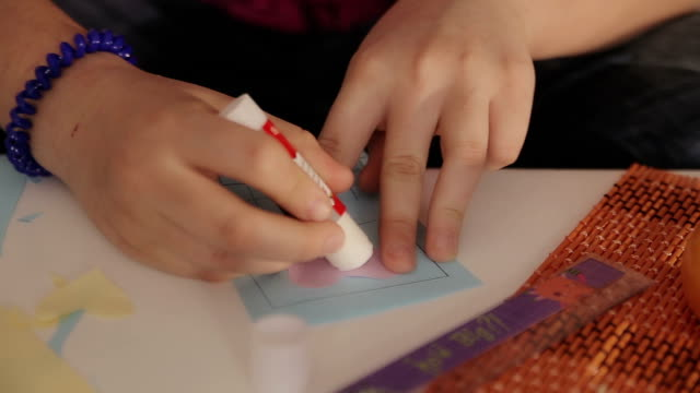 teenage girl using glue for paper,closeup - glue stock videos and b-roll footage