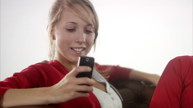 teenage girl using her mobile phone. - one teenage girl only stock videos & royalty-free footage
