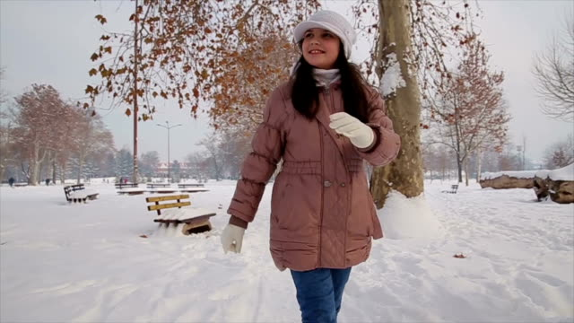teenage girl walking and enjoying in beautiful winter day - coat garment stock videos and b-roll footage