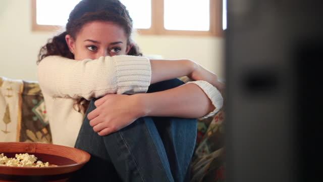ms pan teenage girl (16-17) watching movie at home / lamy, new mexico, usa - teenage girl watching tv stock videos & royalty-free footage