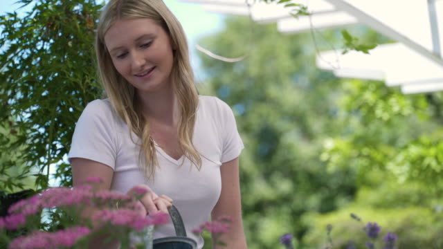 teenage girl watering flowers - one teenage girl only stock videos & royalty-free footage
