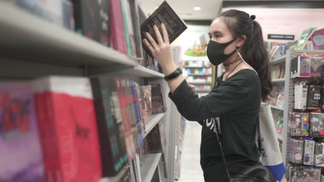 teenage girl wear protective face mask shopping in shopping mall prepare to go back to school - one teenage girl only stock videos & royalty-free footage