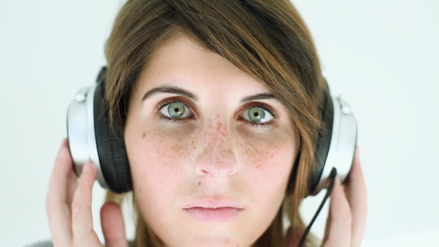 teenage girl wearing headphones and listening to music - freckle stock videos & royalty-free footage