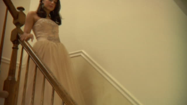ms, la, teenage girl (16-17) wearing prom dresses descending stairs at home, portrait, edison, new jersey, usa - moving down stock videos and b-roll footage