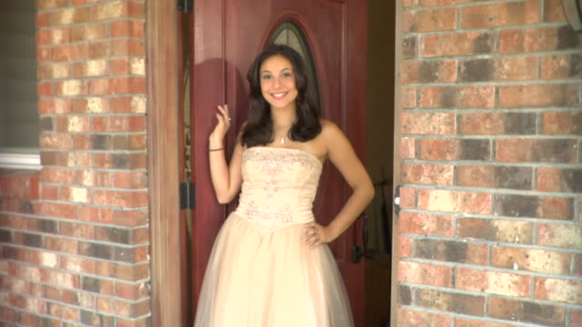 ms, teenage girl (16-17) wearing prom dresses standing in doorway, portrait, edison, new jersey, usa - high school prom stock videos and b-roll footage