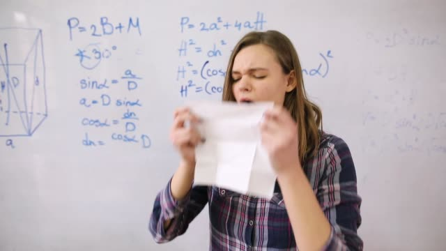 teenage girl with a flu blowing nose in classroom in front of whiteboard - medical condition stock videos & royalty-free footage