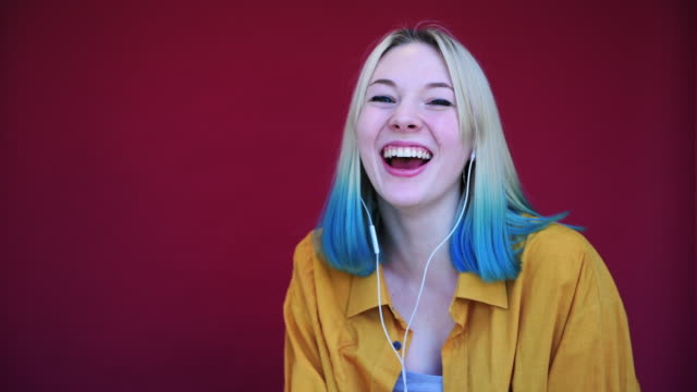 teenage girl with blue hair laughing - hippy stock videos & royalty-free footage