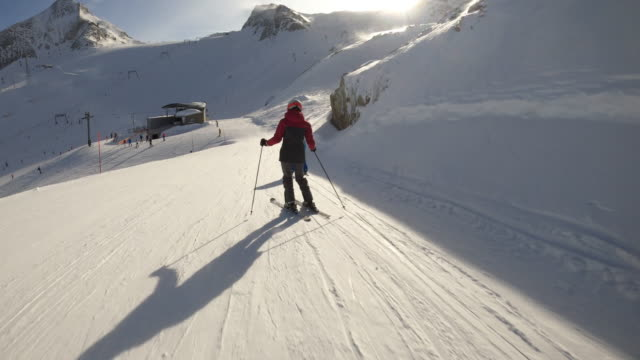 teenage girl with brother skiing at glacier in the alps - ski holiday stock videos & royalty-free footage