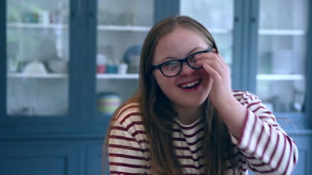 teenage girl with down syndrome, laughing and smiling - waist up stock videos & royalty-free footage