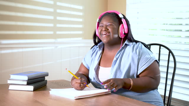 teenage girl with downs syndrome with headphones - nodding head to music stock videos & royalty-free footage
