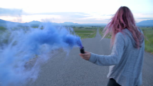 ms sm teenage girl with pink hair playing wiht bule smoke while skateboarding - pink hair stock videos & royalty-free footage