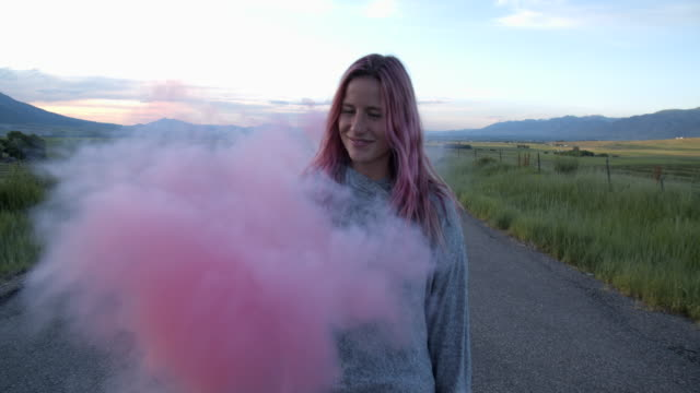 cu teenage girl with pink hair playing with pink smoke - pink hair stock videos & royalty-free footage