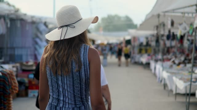 teenage girl with sun hat walking the city streets - sun hat stock videos & royalty-free footage