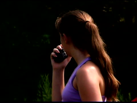 teenage girl with walkie-talkie - one teenage girl only stock-videos und b-roll-filmmaterial
