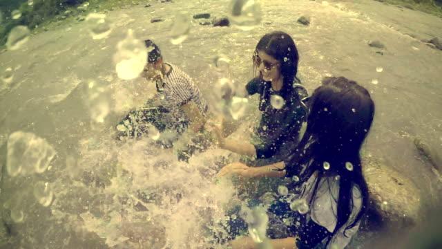 Teenage girls doing fun and enjoying in river.