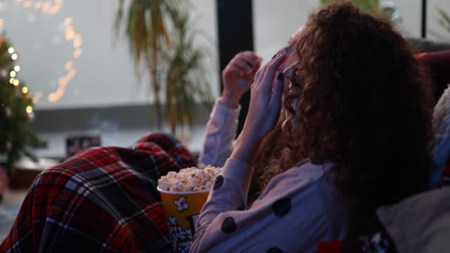 teenage girls eating popcorns and watching movie - bedroom stock videos & royalty-free footage
