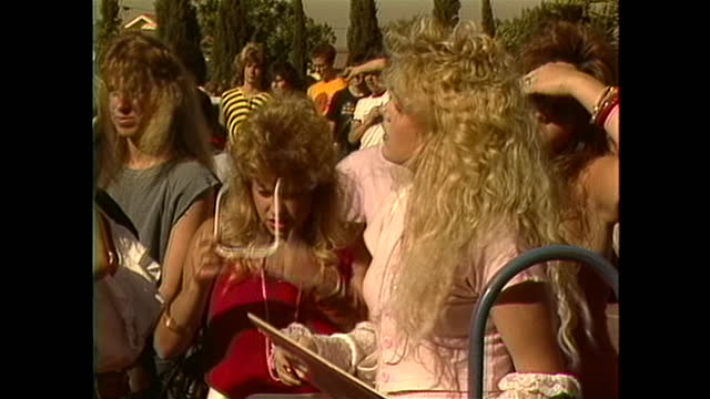 teenage girls hanging out at a stryper band autograph signing. - rock group stock videos & royalty-free footage