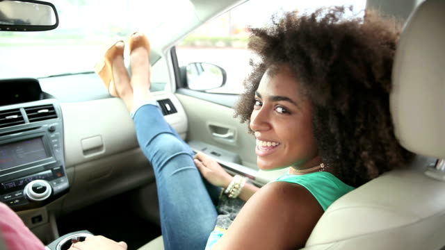 teenage girls hanging out in car, feet up - car interior stock videos & royalty-free footage