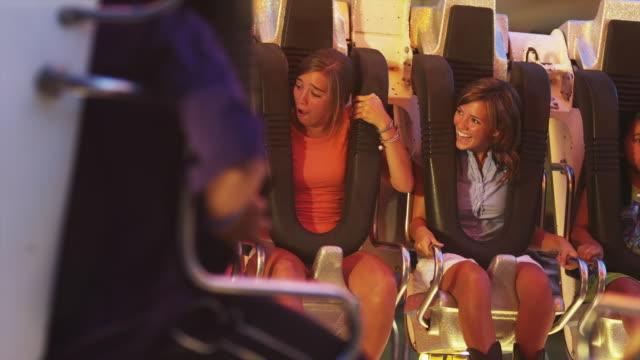 MS Teenage girls (16-17) in amusement park ride / American Fork City, Utah, USA