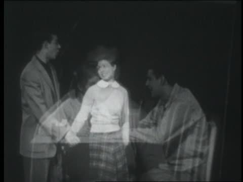 vídeos de stock e filmes b-roll de b/w 1951 lap dissolves teenage girls photo over series of flashbacks of couple on dates - 1951