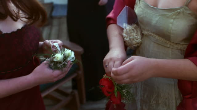 teenage girls put on wrist corsages. available in hd. - high school prom stock videos & royalty-free footage