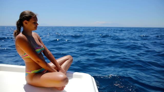 teenage girls relaxing on sailboat - bikini stock videos & royalty-free footage