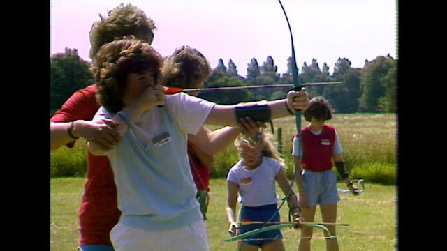 teenage girls shoot bows and arrows at target; 1984 - 1984 stock videos & royalty-free footage